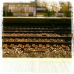 Train tracks with grunge border.